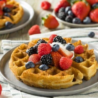 Belgian waffles with fruit and cream