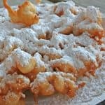 bite sized funnel cake covered in powdered sugar