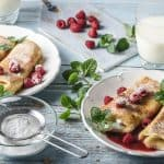 blintzes with cream and berries