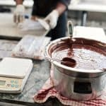 Candy thermometer in pot of chocolate
