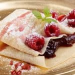 crepe with jam and raspberries