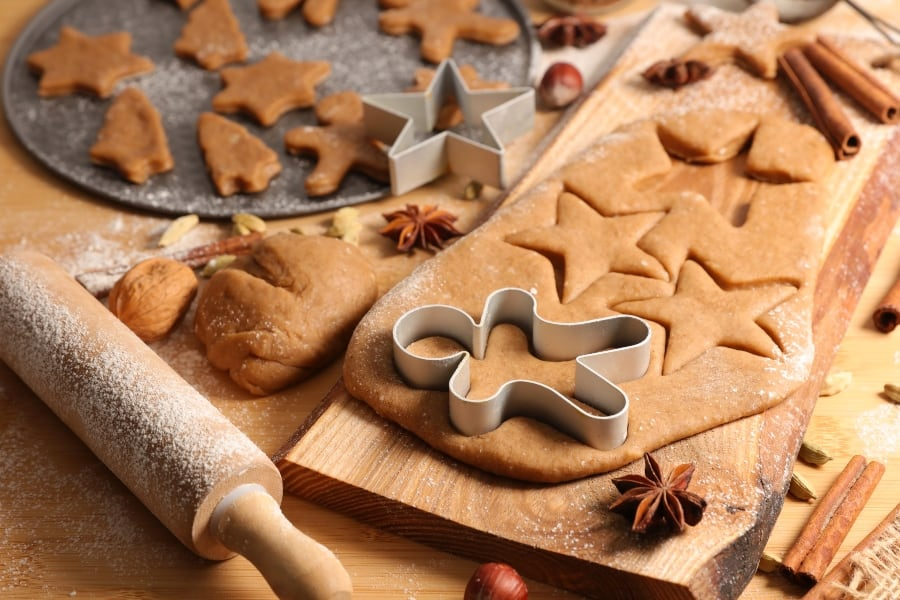 gingerbread cookies being cut into shapes