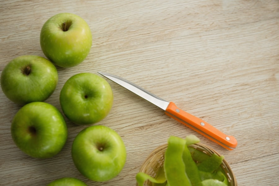 granny apples being peeled