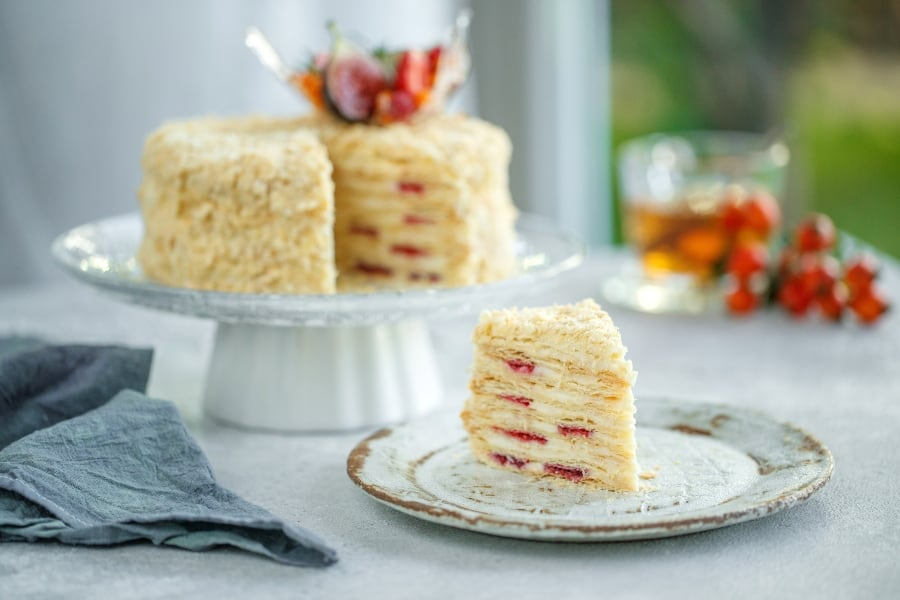 layer cake with berries and french buttercream