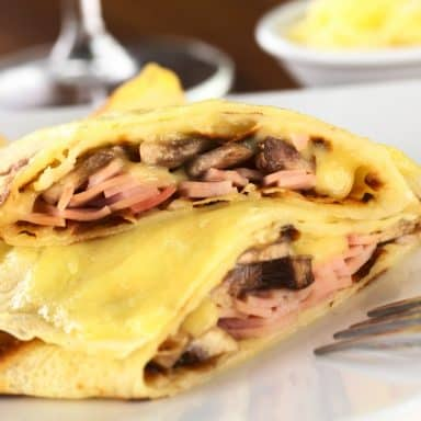 mustard cream sauce topped ham and mushroom crepes