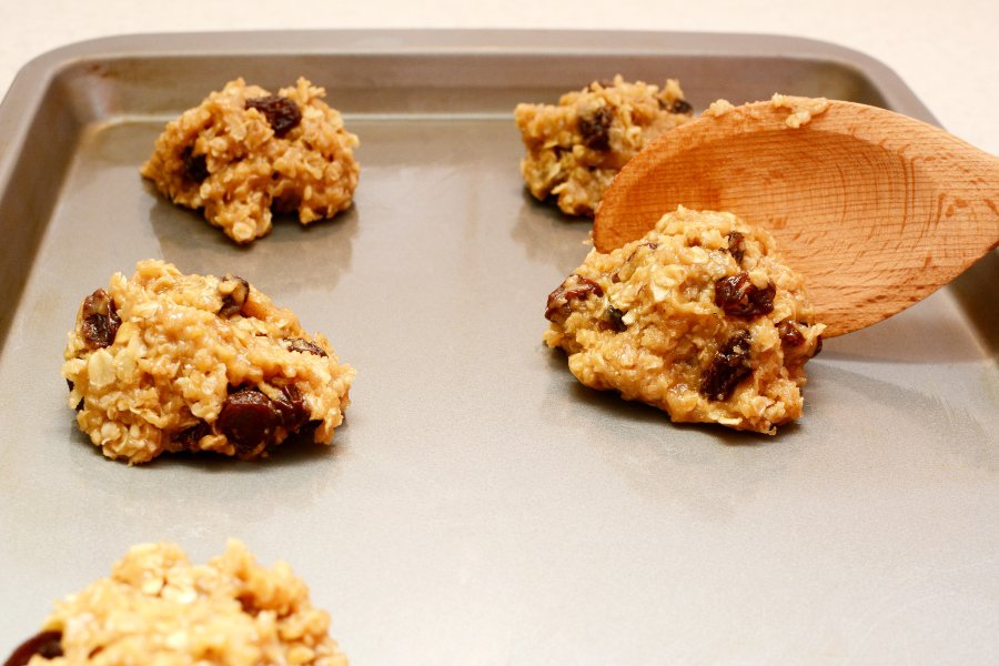 oatmeal cookie dough scooped onto baking sheet