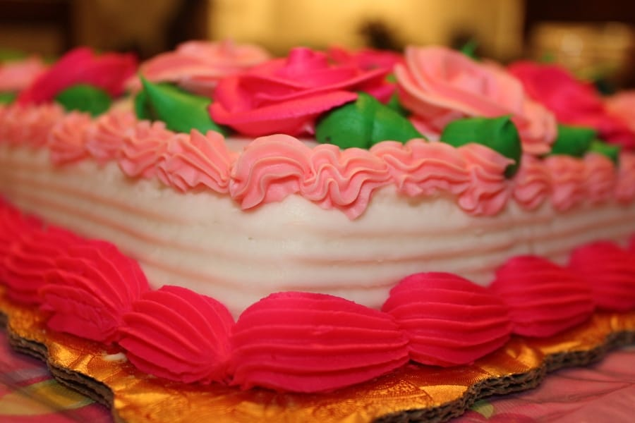 pink sheet cake with decorations