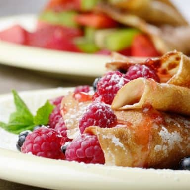 sour cream crepes with raspberries