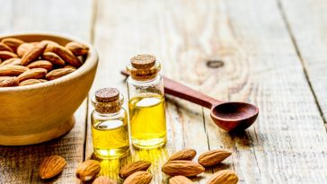almond extract and bowl of whole almonds