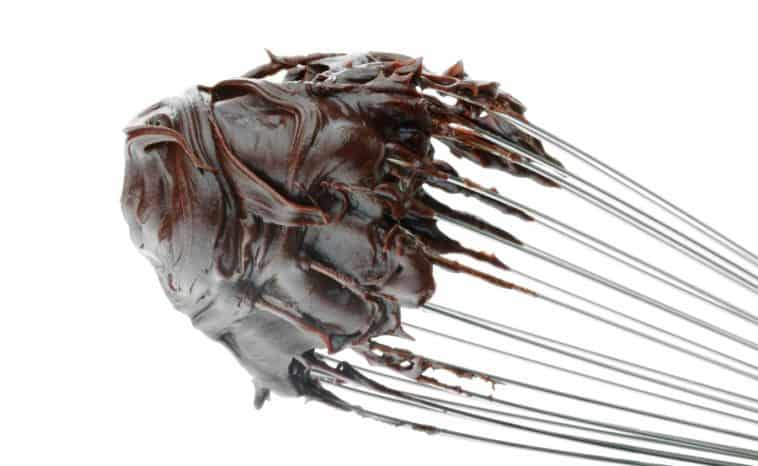chocolate frosting on whisk