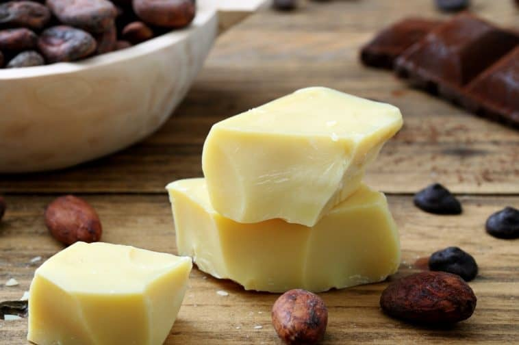 cocoa butter and cocoa beans on table