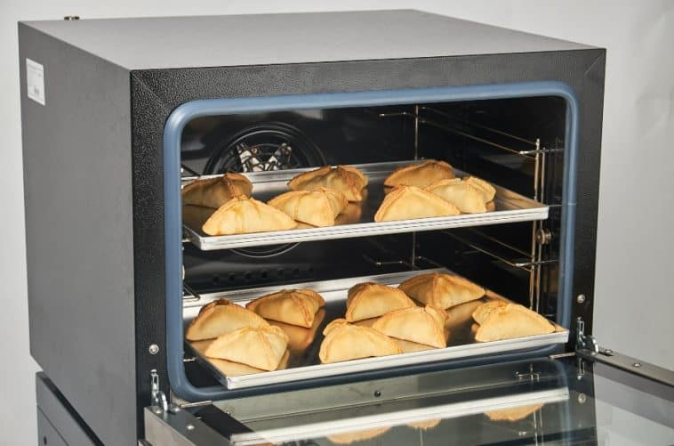 convection oven with pastries in it