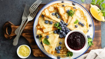 homemade crepes on plate with fruit