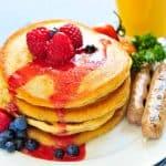 pancake breakfast on place with orange juice