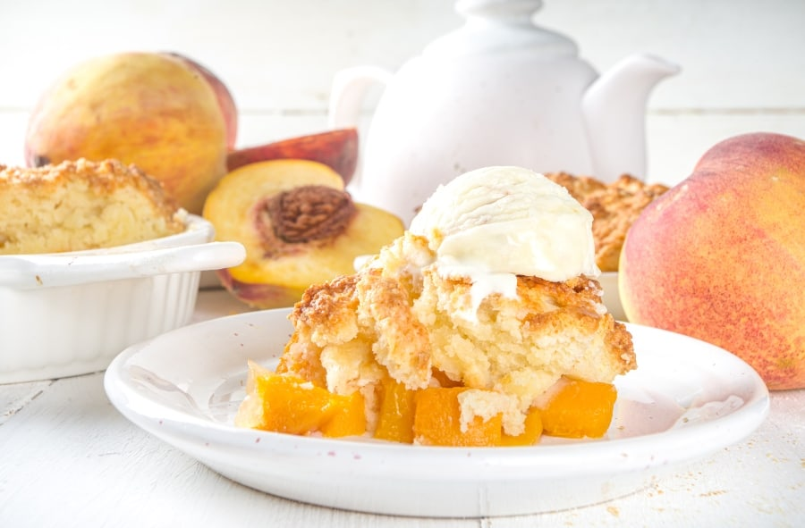 peach cobbler on plate with ice cream