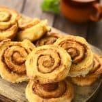 pile of cinnamon rolls on serving dish