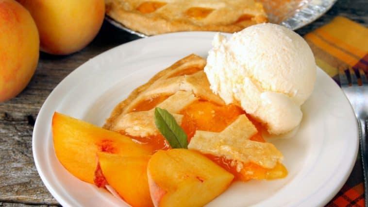 slice of peach pie with ice cream