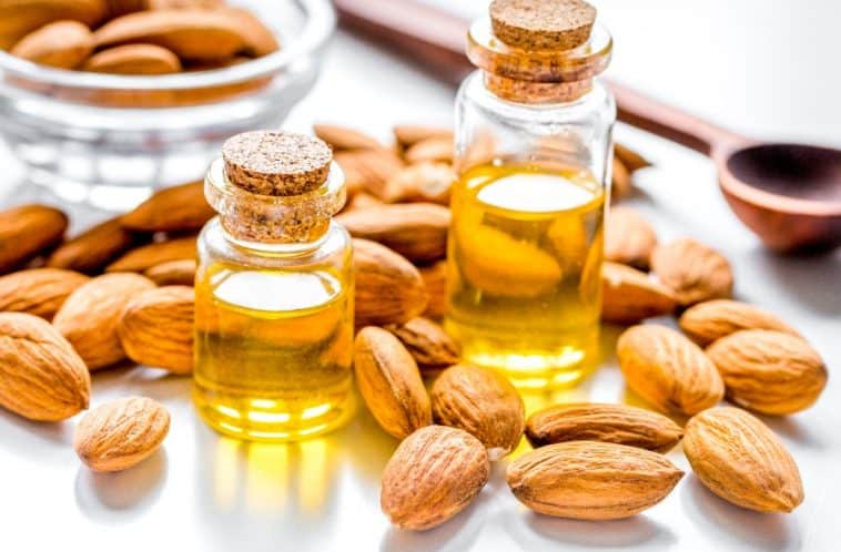 whole almonds and two bottle of almond extract