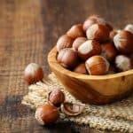 wooden bowl of hazelnuts