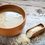 bowl of tahini and scoop of sesame seeds