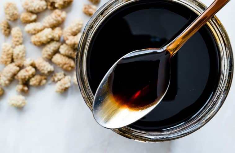 jar and spoon of molasses