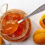 jar of apricot jam with spoon