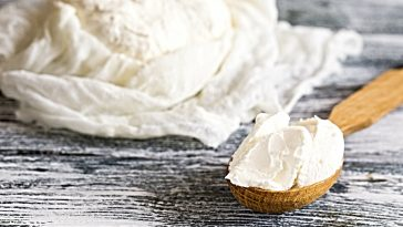 mascarpone cheese in a wooden scoop