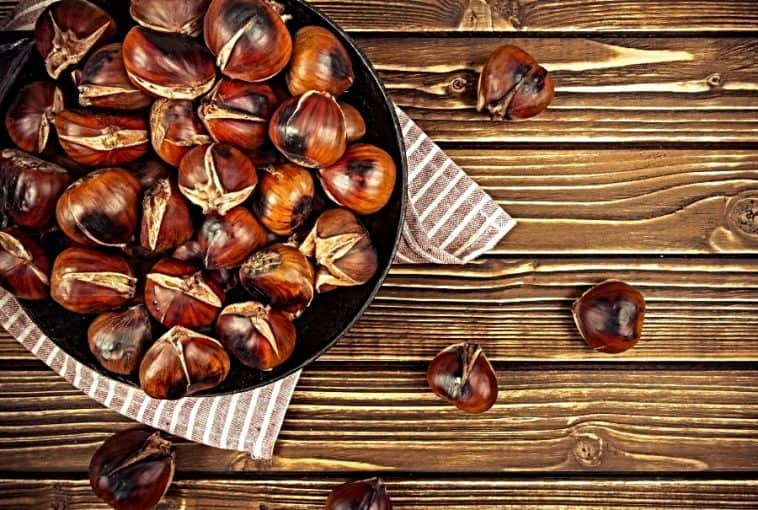 wooden bowl of chestnuts