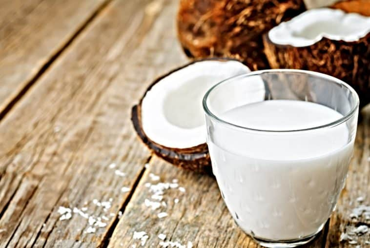 glass of coconut milk and coconuts