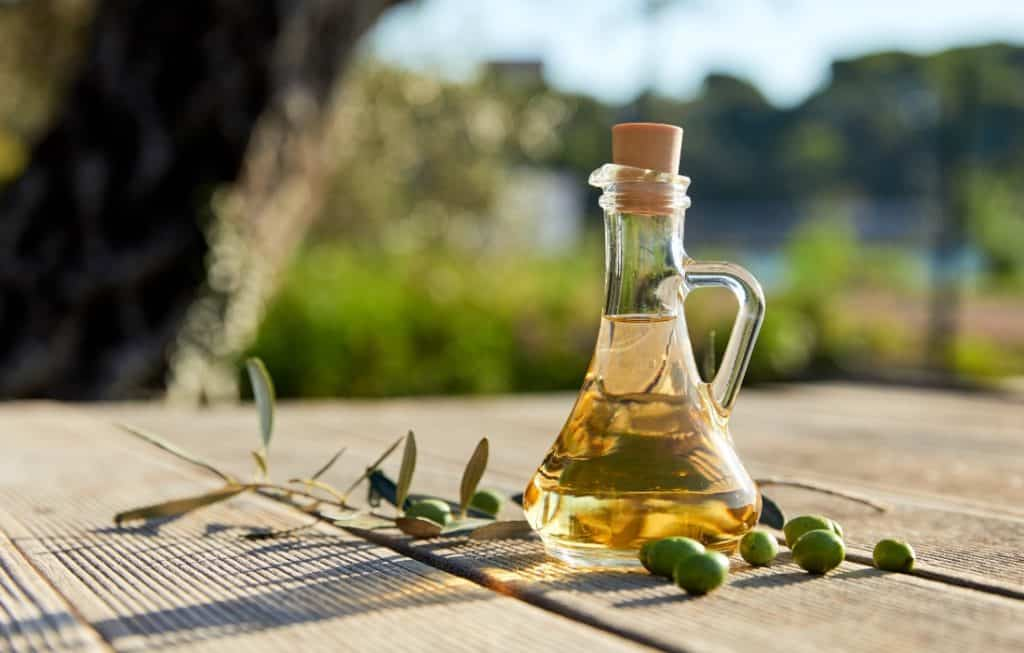 olive oil in jar on table outside