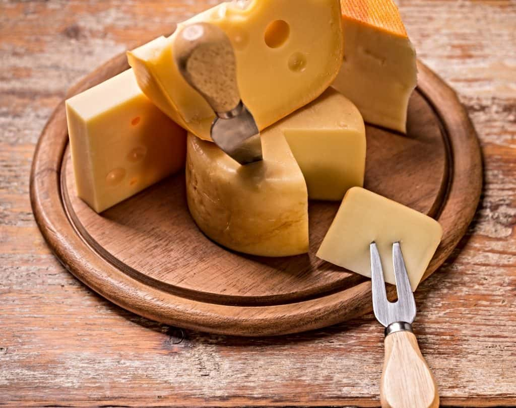 Edam cheese on wood board