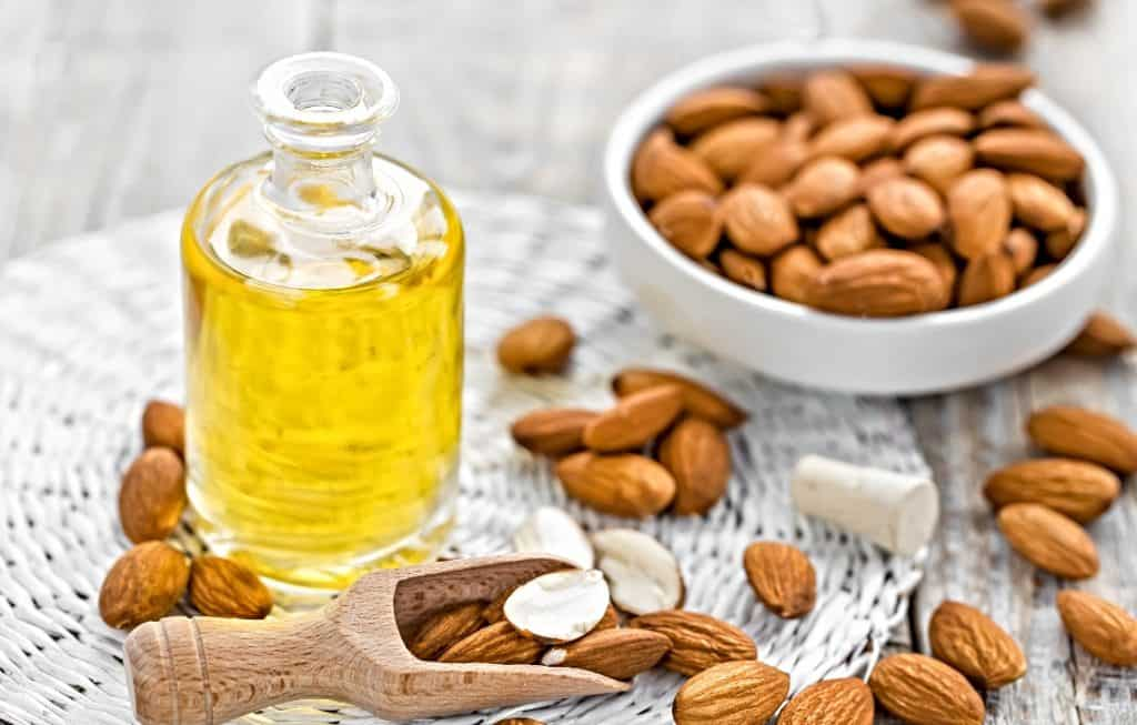 almonds and almond oil in jar