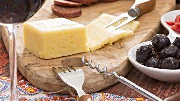 block of Havarti cheese on cutting board