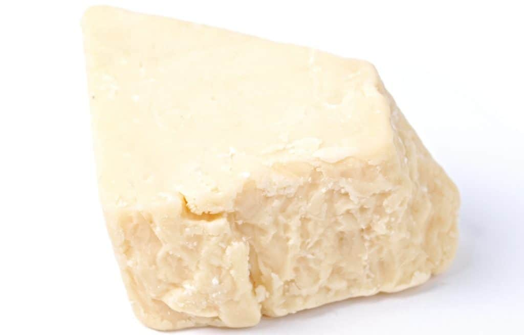 block of white cheddar cheese