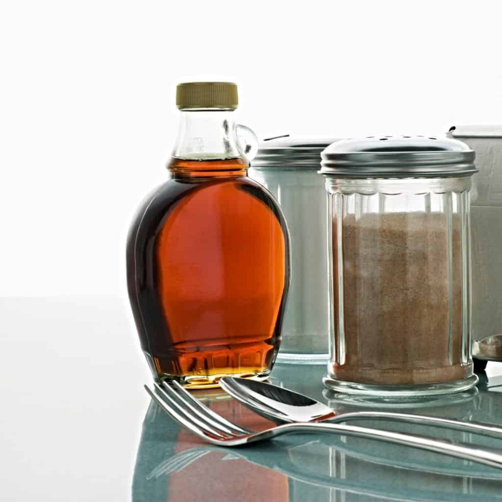 bottle of maple syrup on counter