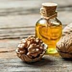 bottle of walnut oil and walnuts