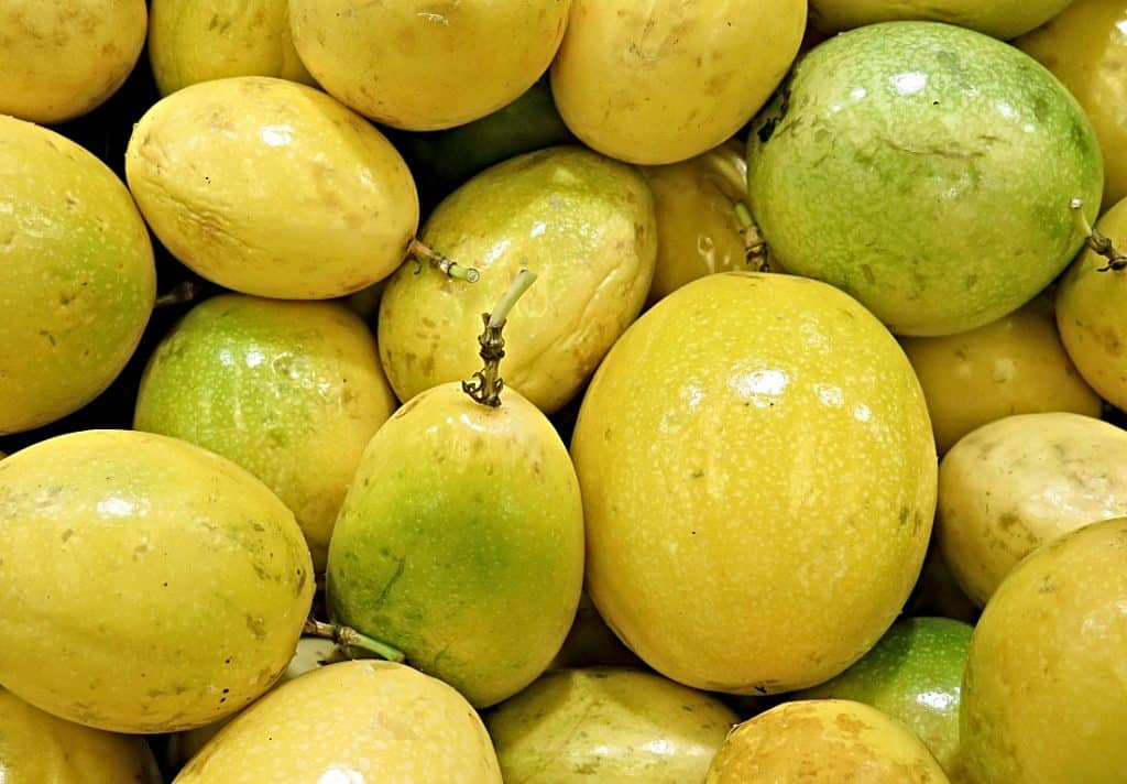 bunch of yellow passion fruit