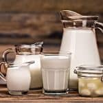 containers of milk, sour cream, half and half, and light cream