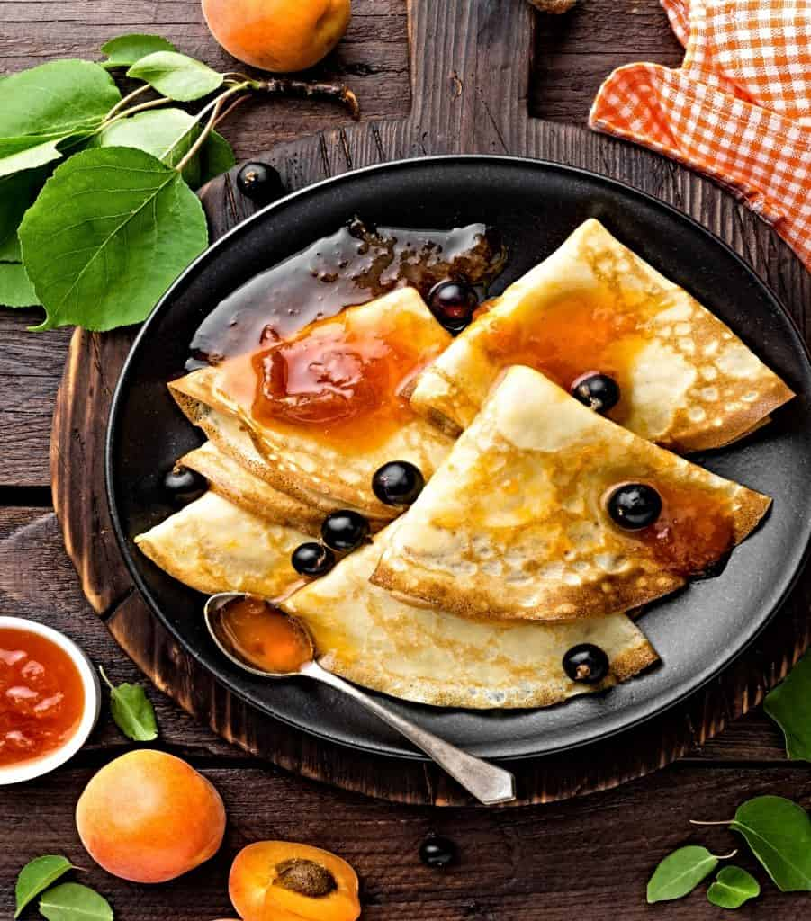 crepes topped with apricot jam