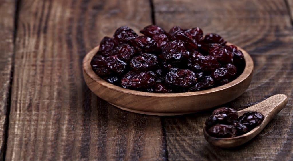dry cranberries in wood bowl