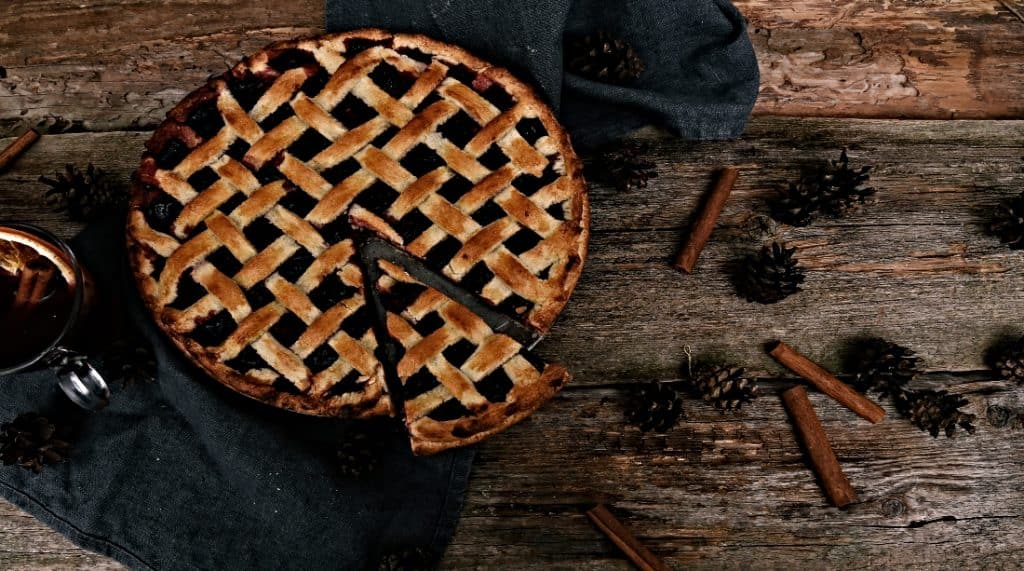 fresh blueberry pie on rustic table
