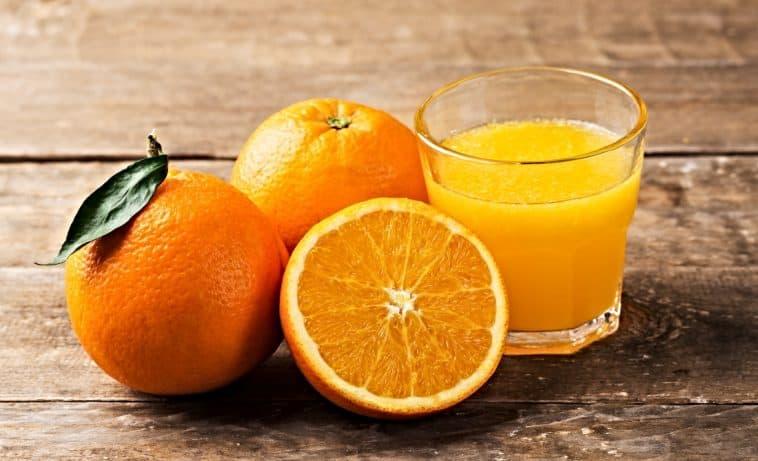 fresh squeezer orange juice and oranges
