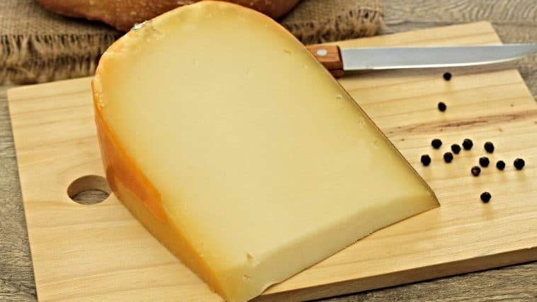 gouda cheese on cutting board