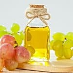 grapeseed oil in can with grapes