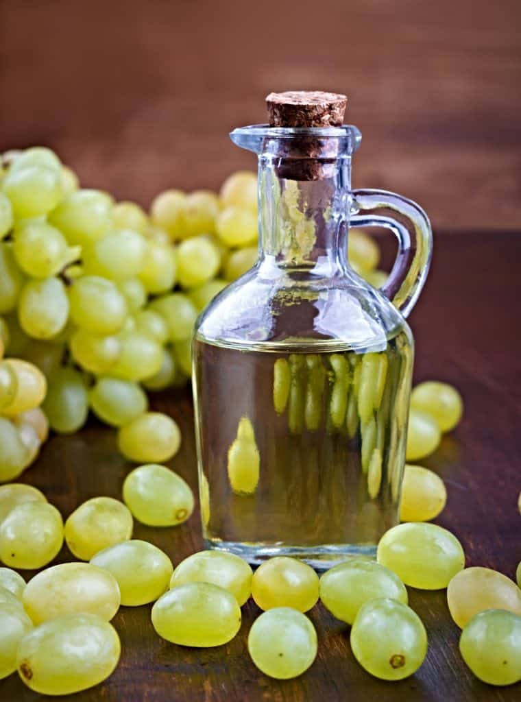 grapeseed oil in decanter with grapes