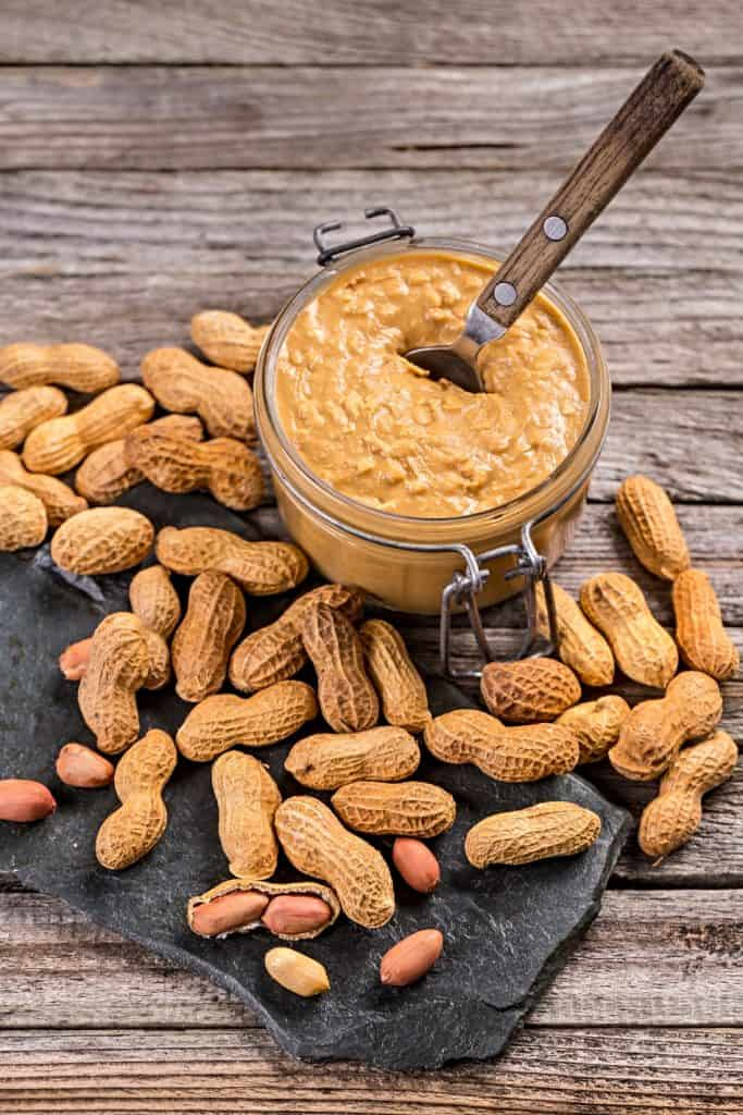 jar of crunchy peanut butter and whole peanuts