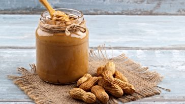jar of natural peanut butter and whole peanuts