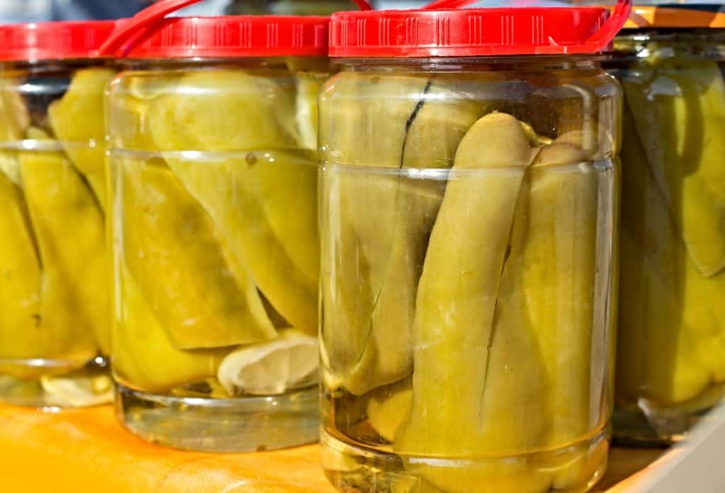 jars of pickles in white vinegar