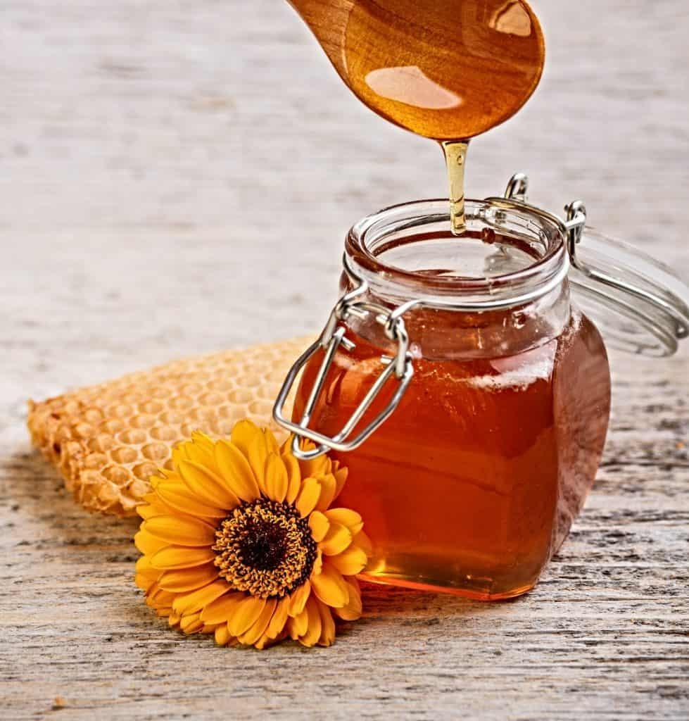 natural organic honey in glass jar