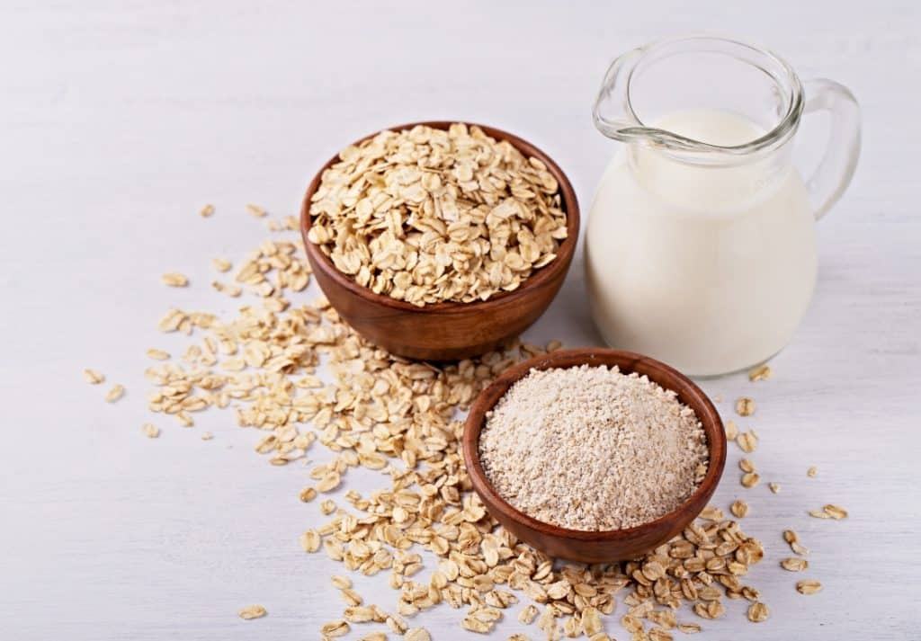 oat milk in pitcher and bowl of oats